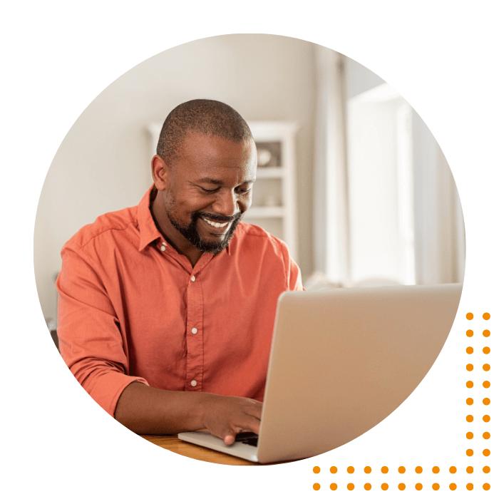 Man smiling at laptop